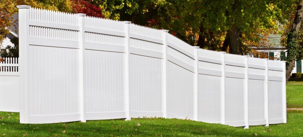 New white vinyl fence in yard